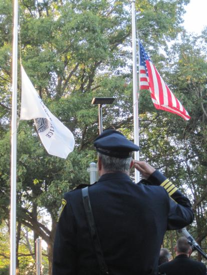 Chief Edward Deveau stands at attention as the honor guard raises the colors to begin the festivities at the ceremonial opening of Watertown's new police station on Oct. 7, 2010.