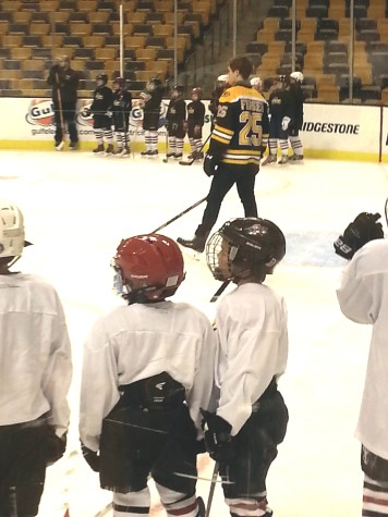 Members of the Watertown Youth Hockey program watch Bruins player Matt Fraser during a clinic at TD Garden on Nov. 19, 2014.