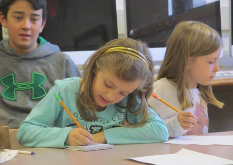 Cunniff Kids News reporters take notes during an interview with new Cunniff Elementary art teacher Jaclyn Meyer on Oct. 6, 2015.
