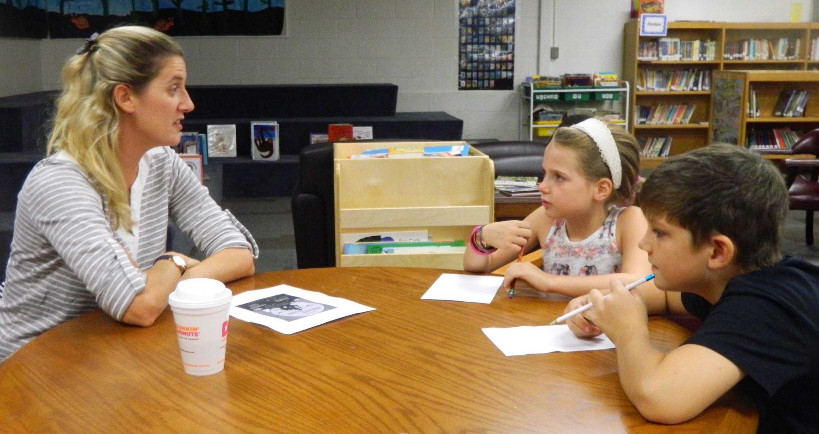 Lee Haley of the Cunniff School PTO (left) talks with Cunniff Kids News reporters about the annual Cunniff Halloween party Oct. 28, 2016.