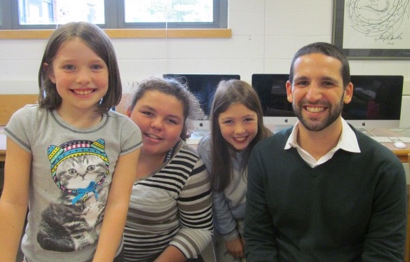 Adam Silverberg (right), the world language coordinator for the Watertown public schools, poses with reporters after a recent interview in the newsroom of the Cunniff Kids News.