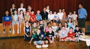 Reporters from the Cunniff Kids News pose with Patriots reporter Mike Reiss of the Boston Globe (center with black jacket) following a press conference at Cunniff Elementary School on June 11, 2008.