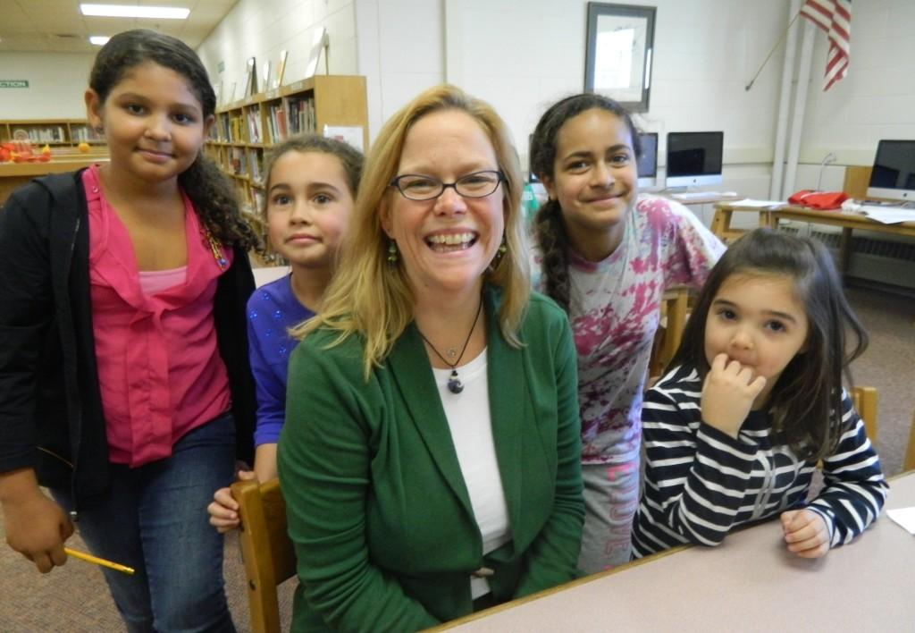 Lisa Cerqueira of the Cunniff School PTO (center) poses with Cunniff Kids News reporters after an interview about the Election Day bake sale.