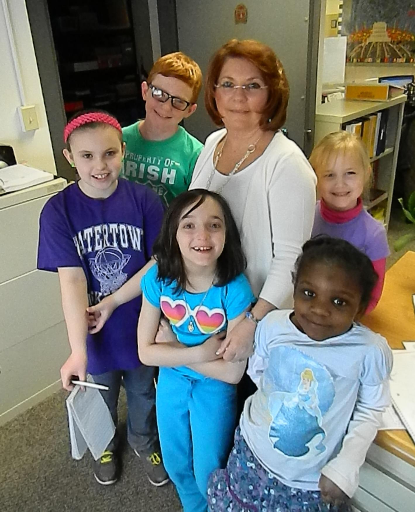 Terri Caporiccio (center) is surrounded by reporters from the Cunniff Kids News. She will be competing in the