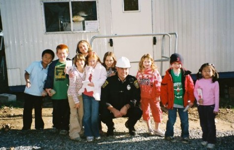 Watertown Police Officer Lloyd Burke (center) and Cunniff Kids News reporters at the construction trailer at the new Watertown Police Department headquarters on Nov. 12, 2008.