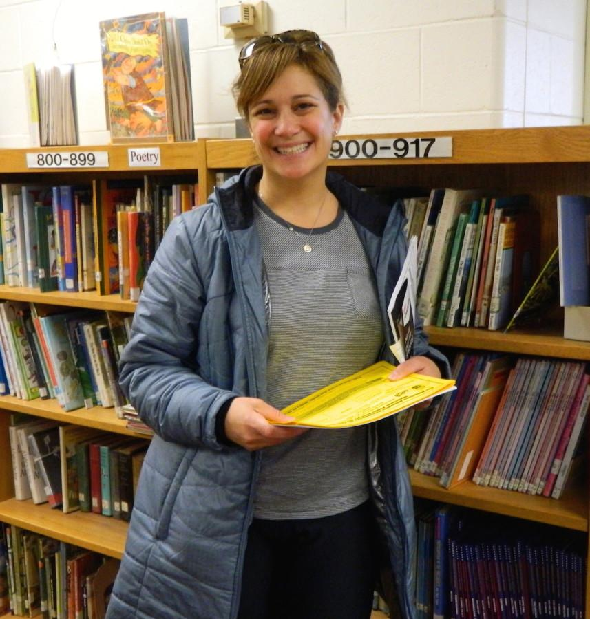 Elaina Griffith of the Watertown Education Foundation and one of the organizers of the fifth annual Spelling Bee for Watertown public school students, poses during her visit to the Cunniff Kids News newsroom on Jan. 13, 2015.