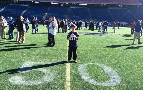 "The author (above) on the field at Gillette Stadium on Oct. 12, 2014, for ""Game with the Greats,"" a fund-raiser put on by the New England Patriots Alumni Club. Among the former Patriots players on hand were Harold Shaw, Gino Cappelletti, Steve Grogan, Steve King, Ronnie Lippett, Patrick Pass, and Pete Brock, one of the founders of the club in 1997."