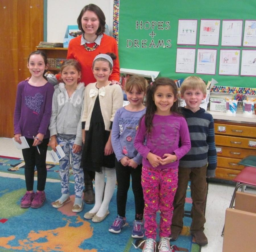 Reporters+from+the+Cunniff+Kids+News+pose+with+new+second-grade+teacher+Olivia+Cifrino+%28third+from+left%29+at+Cunniff+Elementary+School+in+Watertown%2C+Mass.