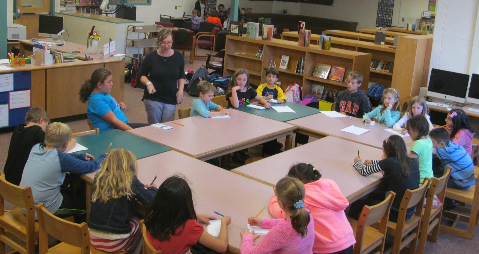 Jaclyn Meyer (standing left), the new art teacher at Cunniff Elementary in  Watertown