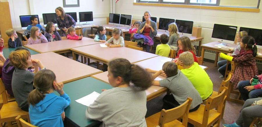 Lee Haley (back row center, in grey sweater),  a parent volunteer with the Cunniff School PTO, talks with Cunniff Kids News reporters about the annual Halloween Party to be held Friday, Oct. 30, 2015.