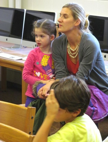 Lee Haley (in grey sweater), a parent volunteer with the Cunniff School PTO, talks with Cunniff Kids News reporters about the annual Halloween Party to be held Friday, Oct. 30, 2015.
