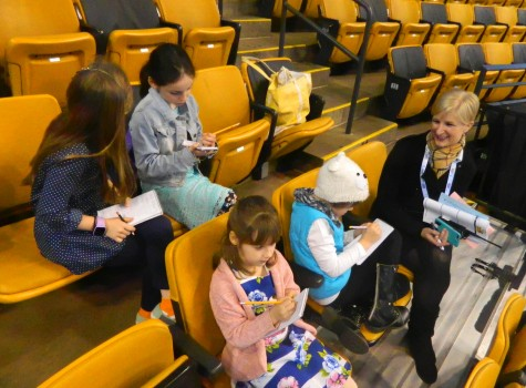 Mimi McKinnis, the communications coordinator for US Figure Skating, answers questions from Cunniff Kids News reporters while in the TD Garden stands on Monday, March 2018 -- the first day of the 2016 World Figure Skating Championships.
