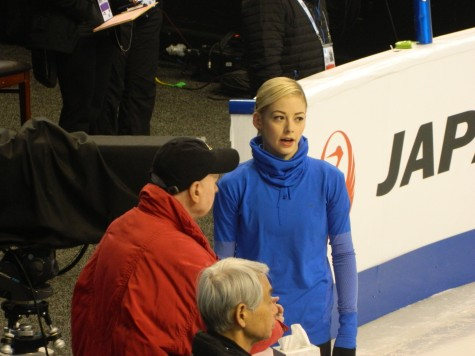 US national champion Gracie Gold talks with coach Frank Carroll during the first day of practice for the 2016 World Figure Skating Championships at TD Garden in Boston on Monday, March 28.