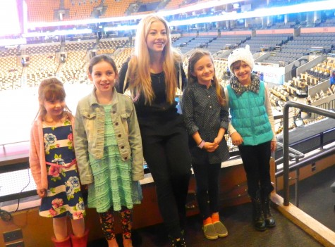 Gracie Gold (center) poses with reporters from the Cunniff Kids News at TD Garden on Monday, March 28 -- the first day of the 2016 World Figure Skating Championships.
