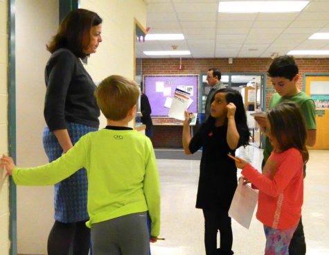 Cunniff Kids News reporters interviewed 18 staff members -- including principal Mena Ciarlone (left) -- at Cunniff Elementary School in Watertown, Mass., in search of people's favorite food at Thanksgiving.