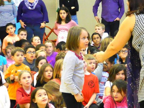 Shenea Booth, hand balancer from Cirque Dreams Holidaze, answered questions from students during her visit to Lowell Elementary School in Watertown, Mass., on Friday, Nov. 18, 2016.