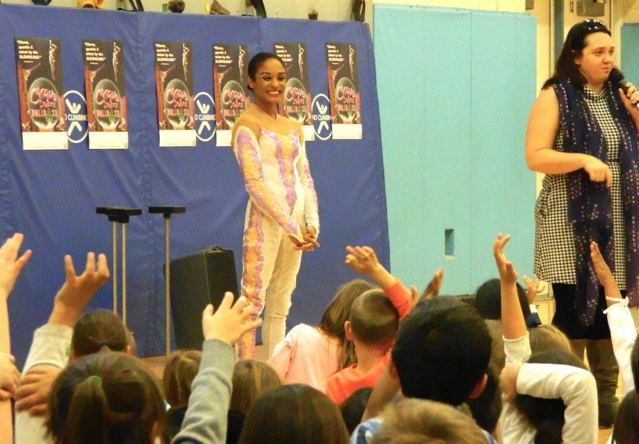 Shenea Booth (center), hand balancer from Cirque Dreams Holidaze, answered questions from students during her visit to Lowell Elementary School in Watertown, Mass., on Friday, Nov. 18, 2016.