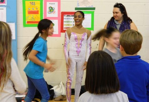 Shenea Booth (center), hand balancer from Cirque Dreams Holidaze, visited Lowell Elementary School in Watertown, Mass., on Friday, Nov. 18, 2016.