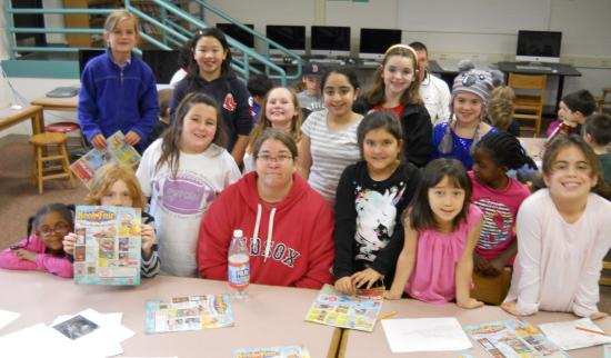 Cunniff parent Maura Gallagher (front row in Red Sox sweatshirt) poses with reporters in the newsroom of the Cunniff Kids News while promoting the Nov. 26-30 Scholastic Book Fair in the cafetorium.
