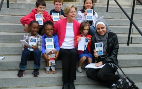 US Senate candidate Elizabeth Warren (center) poses on the Town Hall steps with credentialed student reporters from Watertown school newspapers during a campaign stop on Sept. 22, 2012.