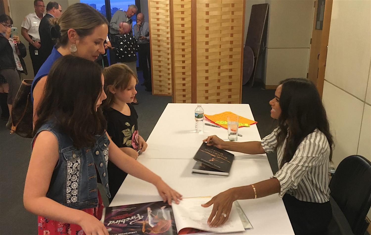 Misty Copeland (right) speaks with reporters from the Cunniff Kids News after her talk at the JFK Library on Aug. 28, 2017.