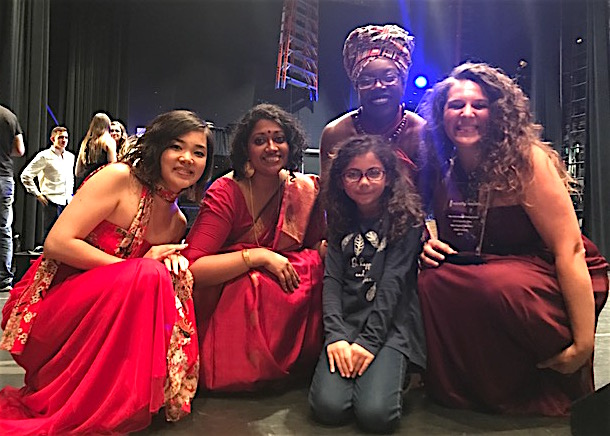 The Women of the World a cappella group pose with its first-place trophy (right) and a reporter from the Cunniff Kids News (center) after the New England a cappella semifinals at Berklee Performance Center on July 29, 2017.