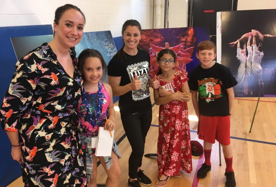 Cirque du Soleil artistic director Gracie Valdez (left) and aerialist Kelly McDonald (center) poses with reporters from the Cunniff Kids News after their visit to Cunniff Elementary School in Watertown, Mass., on June 11. Their new show Luzia will be in Boston from June 27 to Aug. 12, 2018, at Suffolk Downs.